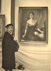 Maria Kozniewska in front of portrait of pani Jadwigi Evertowej 1933